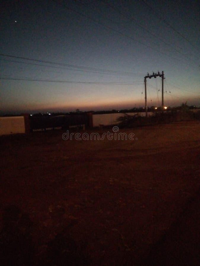 Postérieur de coucher du soleil de maison photos stock