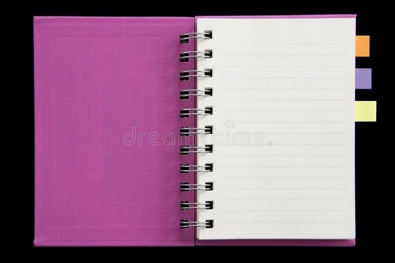 Post-it à la mini page de poing de cahier ouverte photo libre de droits
