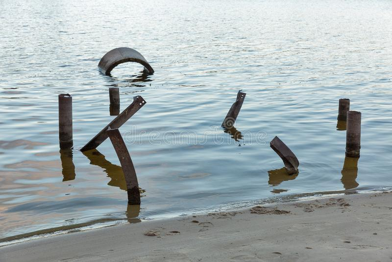 Post apocalypse constructions in water. Dnieper river, Ukraine stock photos