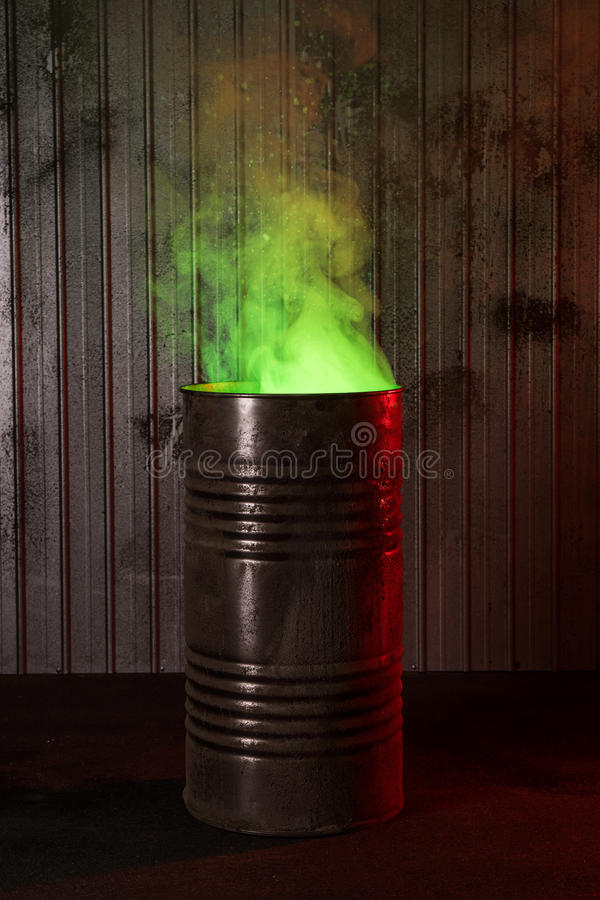 Post-apocalyptic background with old rusty barrel stock image