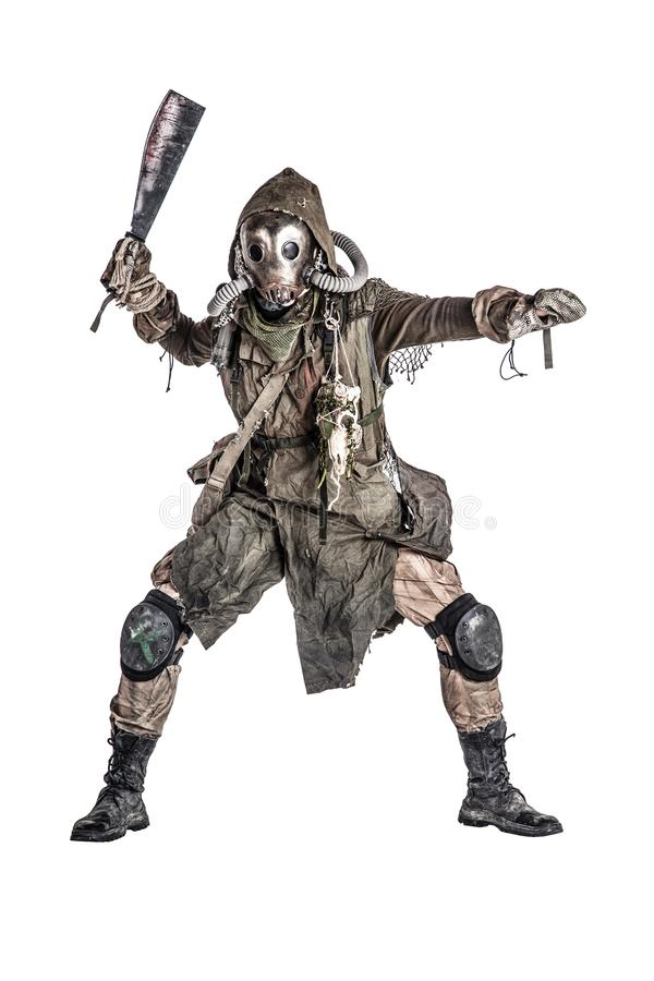 Post apocalyptic human threatening with cane knife. Aggressive and evil humanoid monster or creature of post apocalyptic, poisoned by dangerous pollution world stock photography