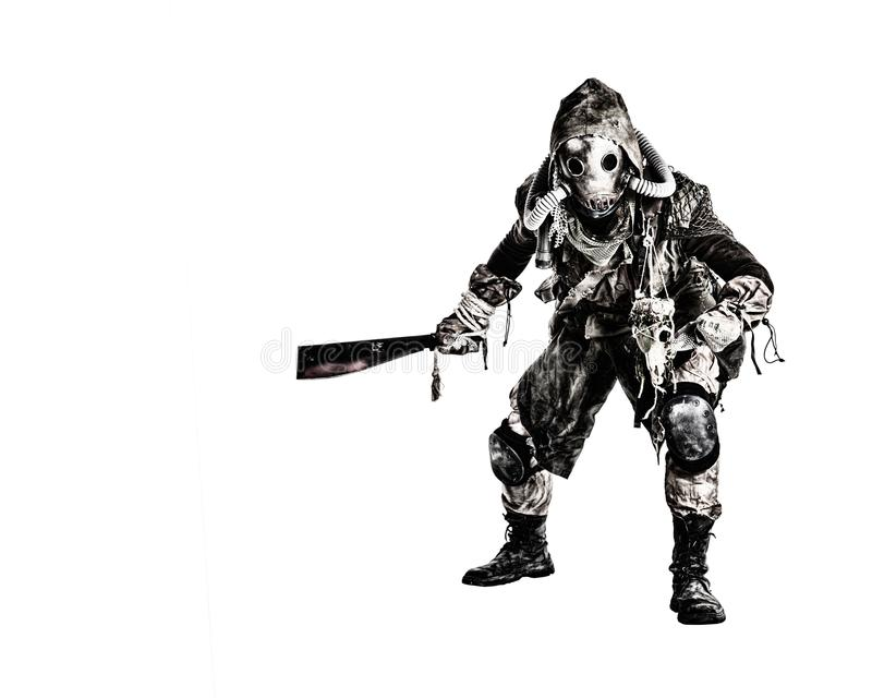 Post apocalyptic human threatening with cane knife. Aggressive and evil humanoid monster or creature of post apocalyptic, poisoned by dangerous pollution world stock photo