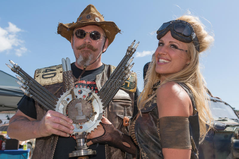 Post-apocalyptic survival costume couple. Torrance, USA - May 21, 2016: Post-apocalyptic survival costume couple during 1st Annual Wasteland World Car Show royalty free stock images
