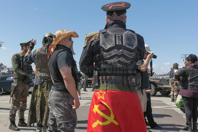 Post-apocalyptic survival costume people. Torrance, USA - May 21, 2016: Post-apocalyptic survival costume people during 1st Annual Wasteland World Car Show royalty free stock photo