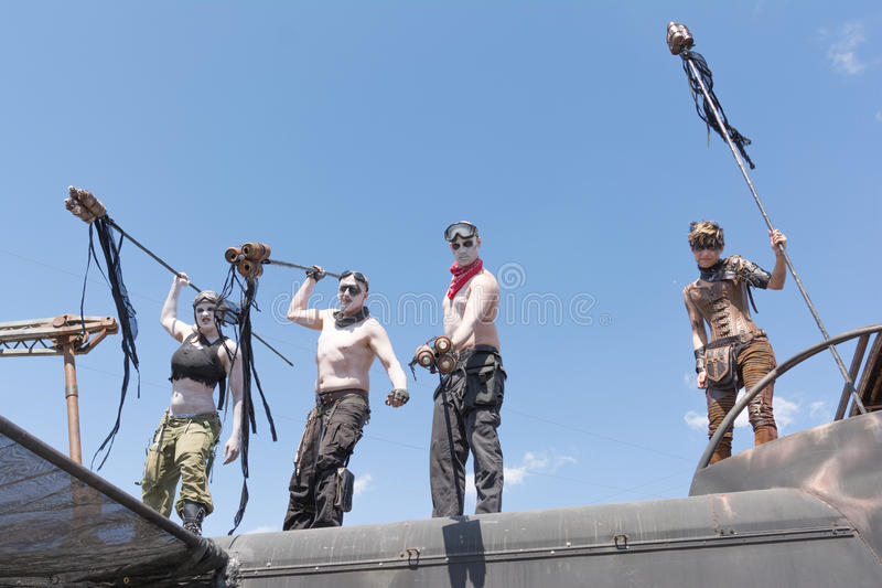 Post-apocalyptic survival costume people. Torrance, USA - May 21, 2016: Post-apocalyptic survival costume people during 1st Annual Wasteland World Car Show stock photography
