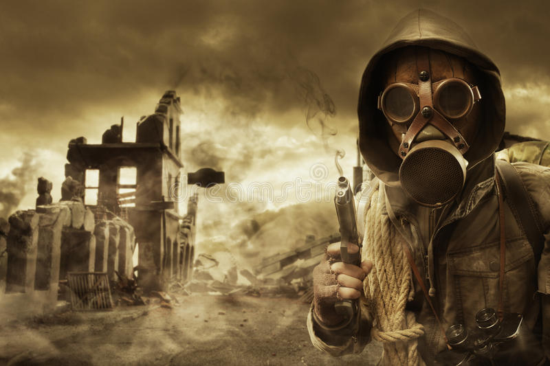 Post apocalyptic survivor in gas mask stock photography