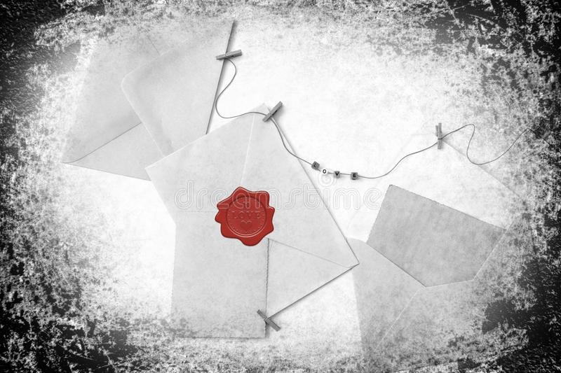 Post blank envelopes and vintage blank cards. Post envelopes and vintage blank cards. Red wax seal with word love and heart shape. All objects are hanging on a stock photos