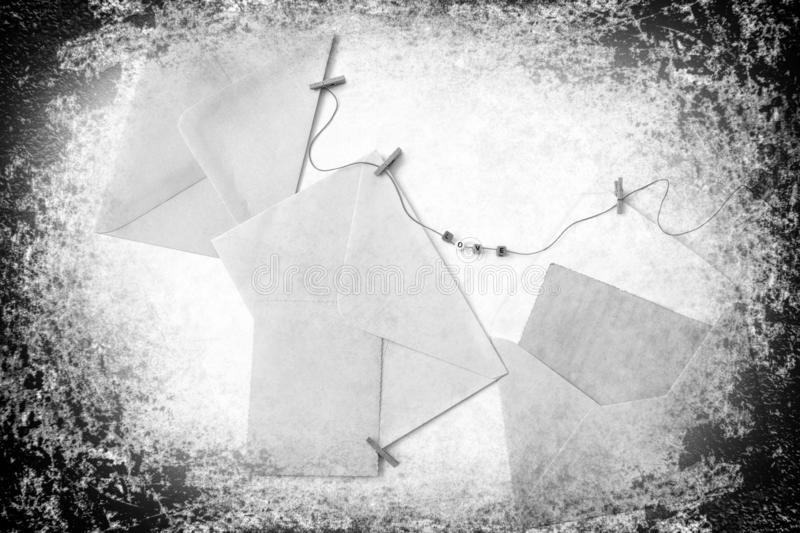 Post blank envelopes and vintage blank cards. Post envelopes and vintage blank cards. Word love made of a plastic letters. All objects are hanging on a rope royalty free stock photo