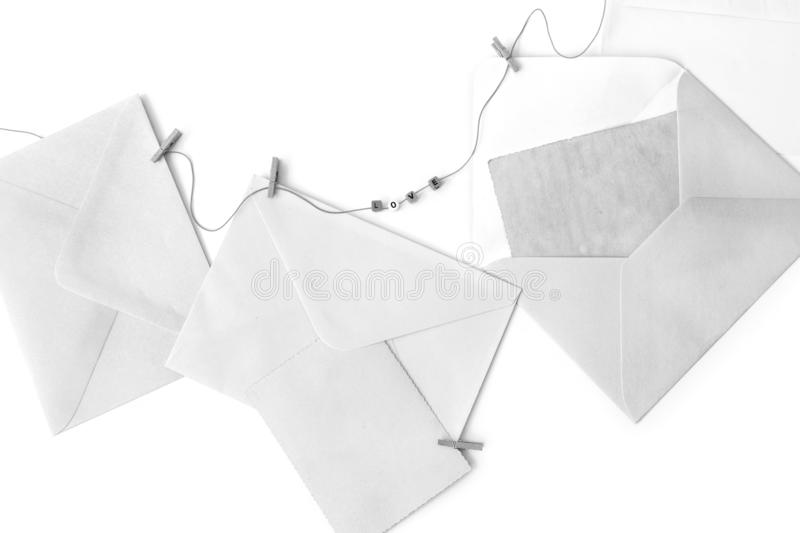 Post blank envelopes and vintage blank cards. Post envelopes and vintage blank cards. Word love made of a plastic letters. All objects are hanging on a rope stock photos