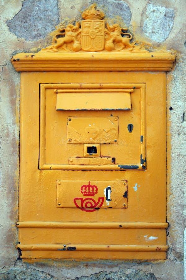 Post box. Yellow metal post box in Majorca in Spain royalty free stock photos