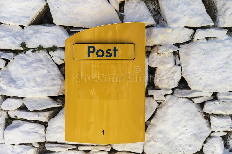 Post Box. Yellow box in Mykonos Island , Greece. royalty free stock photos