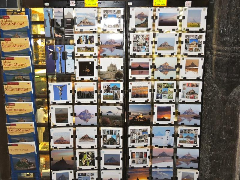 Post cards and maps of mont st michel. Mont saint michel Tourist shop selling picture post cards and maps of the abbey and castle in brittany france stock photos