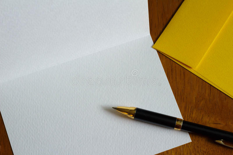 Post cards and pen. Is a greeting card that spell the feeling stock images