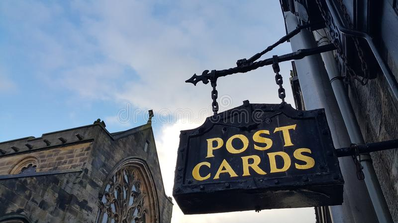 Post cards sign in St andrews. Old fashioned post cards sign in St andrews in Scotland in United kingdom royalty free stock photography