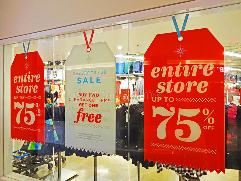 Post Christmas Sale. Photo of sale signs at a shopping mall the day after christmas with discounts up to 75% off. Sometimes waiting two days can allow you to buy stock image
