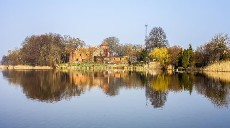 Post Cistercian Structures in Bierzwnik village (part of Cistercian Trail in Poland) reflected in lake, Poland. royalty free stock photography