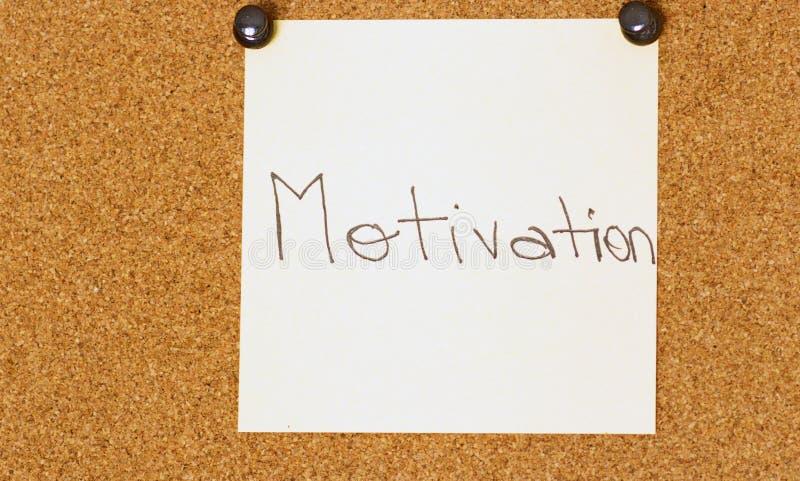 Post-it de motivation sur un fond de coarkboard photo libre de droits