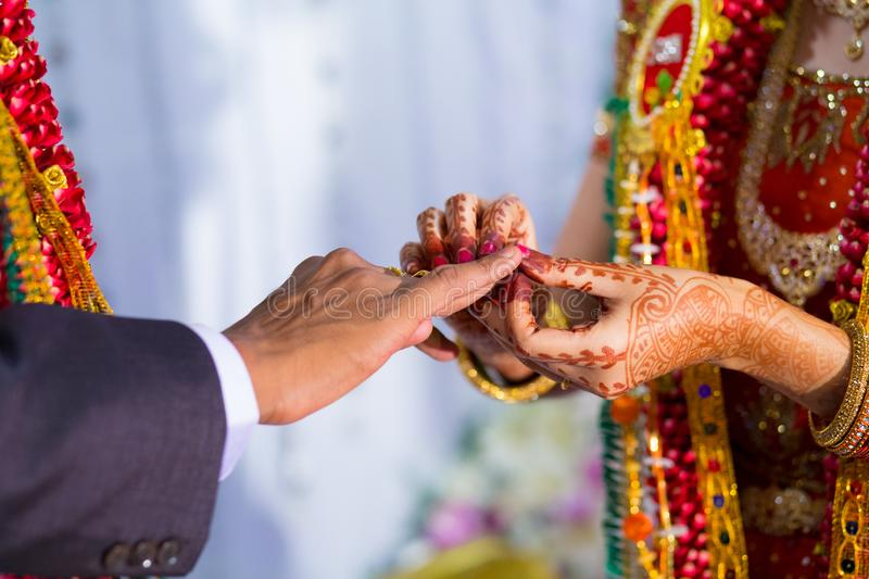 Close up of Engagement or ring ceremony in indian wedding. A post engagement close up photo of the hands with rings of Indian Bride and Groom royalty free stock images