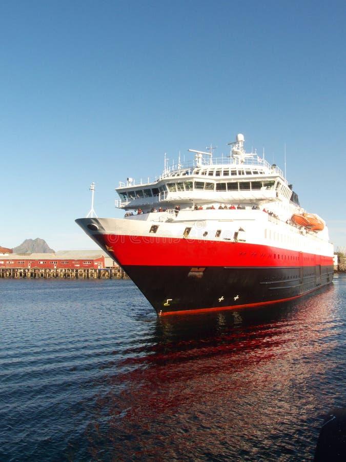 The post express in Lofoten. Ship entering Svolvaer's harbour, Lofoten islands, norwegian arctic sea royalty free stock photography