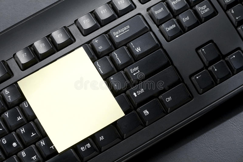 Post-it and keyboard royalty free stock photos