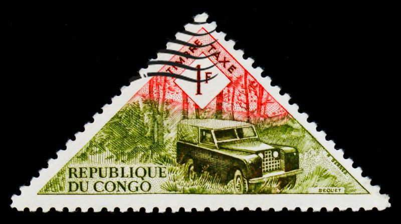 Post land-rover car, Transport serie, circa 1961. MOSCOW, RUSSIA - SEPTEMBER 3, 2017: A stamp printed in Congo shows Post land-rover car, Transport serie, circa stock image