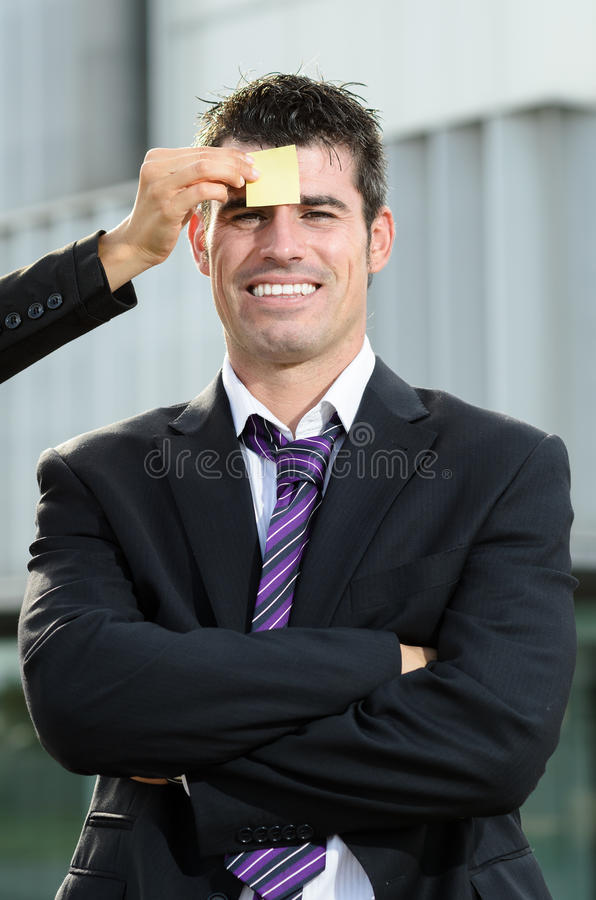 Post-it in man forehead
