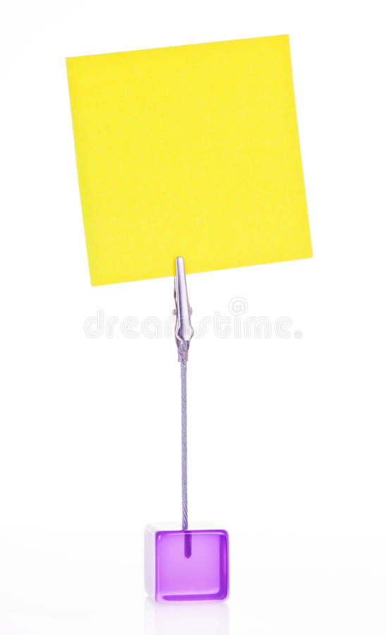 Post-it note. Attached to a cube with clips royalty free stock photos