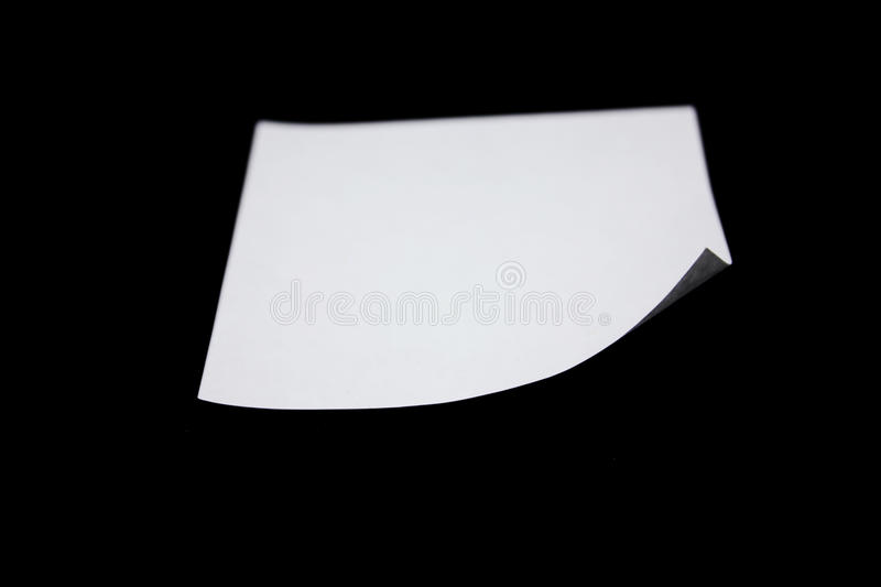 Post-it note. Blank Post-it note stuck on a black background stock photography
