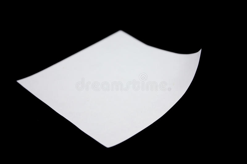 Post-it note. Blank Post-it note stuck on a black background royalty free stock image