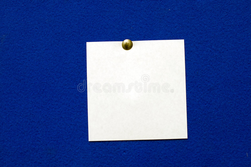 Post-it note. On blue background stock photos