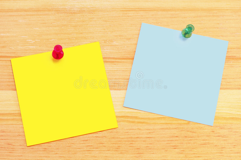 Post-It Notes on Wood Desk stock images