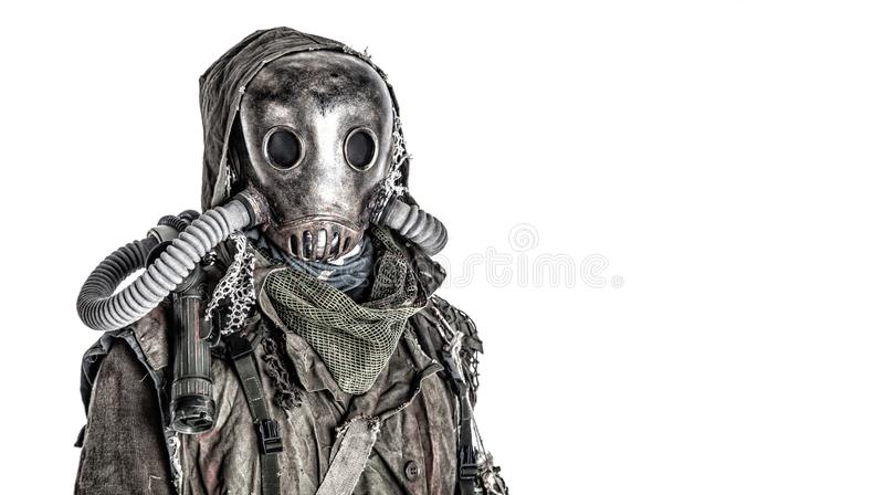 Post nuclear catastrophe survivor in gas mask. Scary post apocalyptic, living underground, creature with vintage lantern on shoulder, wearing rags and creepy royalty free stock images