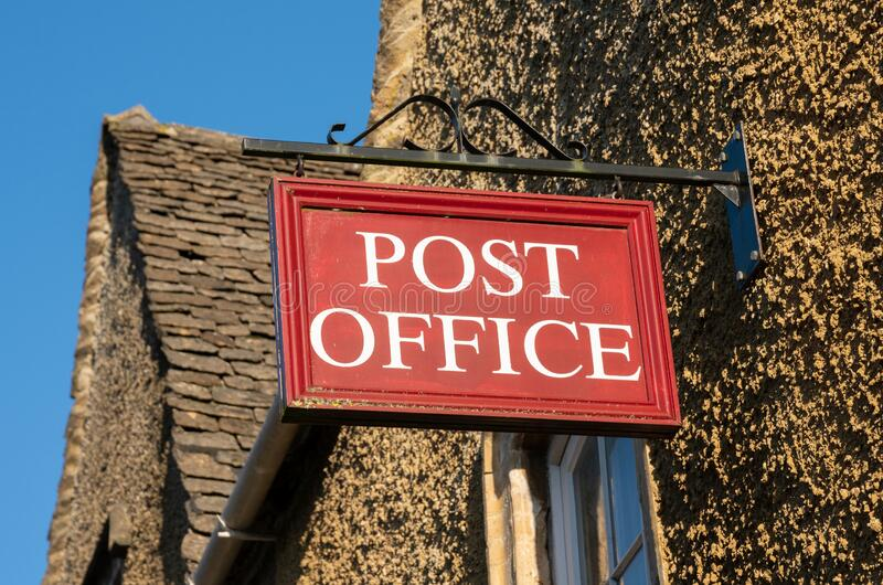 Post Office sign in rural location, England. United kingdom royalty free stock photography
