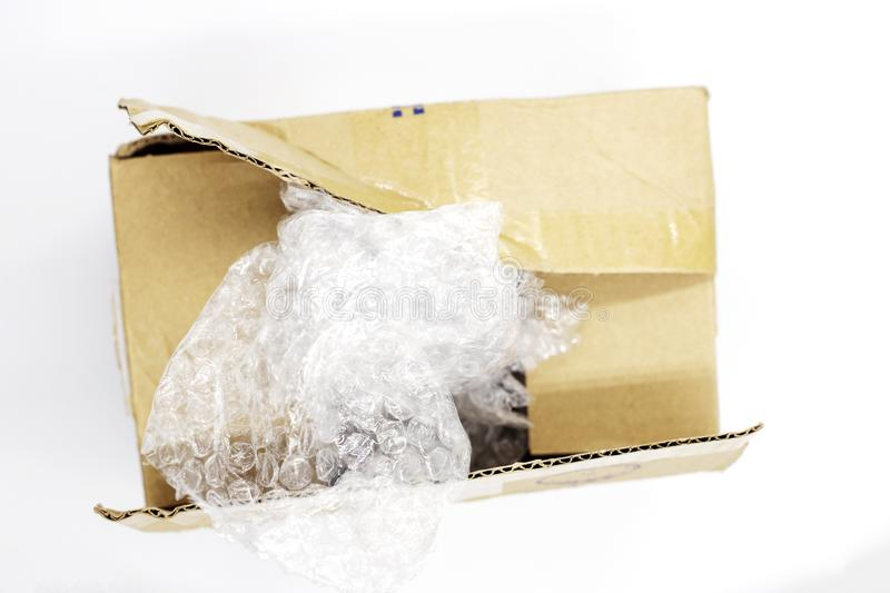 Post parcel box with package plastic on white background, Unboxing process top view photo. Carton box opening. stock photo