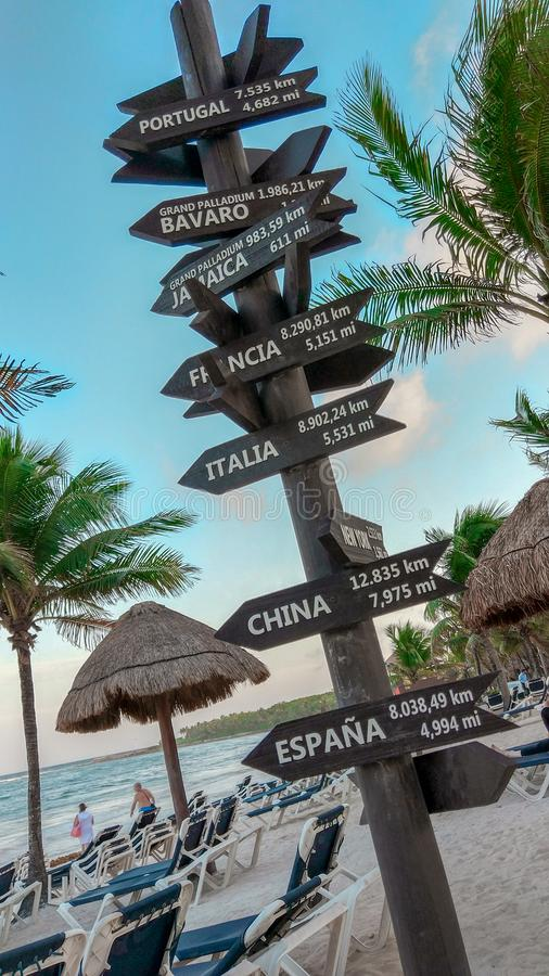 Post with signs of cities around the world stock photos
