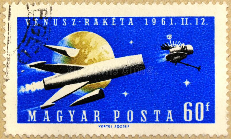 Post stamp of Hungary depicting a rocket, of series dedicated to the Venus space probe royalty free stock photo