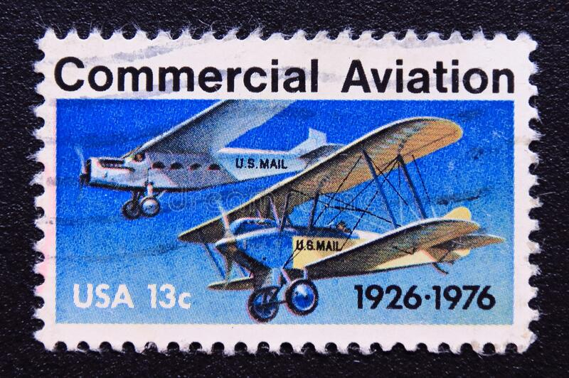 Post stamp printed in USA, 1976, commercial aviation. Post stamp printed in the usa, united states of america. This stamp commemorates the 50th anniversary of stock image