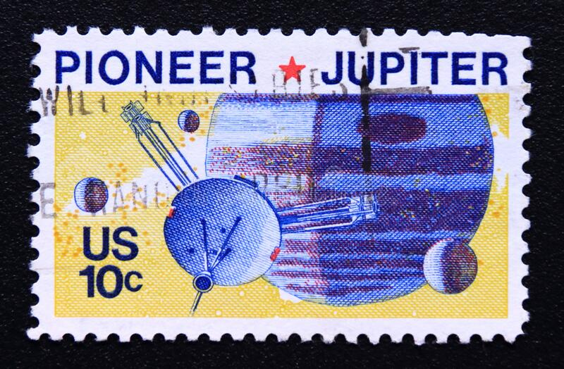 Post stamp printed in USA, 1975, Pioneer 10 Jupiter mission space. Post stamp printed in the usa, united states of america. This stamp commemorates the pioneer royalty free stock image