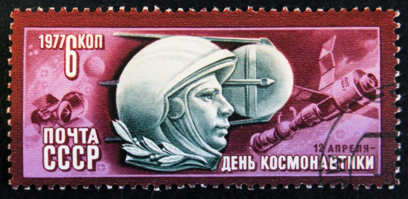 Post stamp printed in USSR devoted to astronautics day, circa 1976. MOSCOW, RUSSIA - APRIL 2, 2017: A post stamp printed in USSR shows April 12 - day of stock images