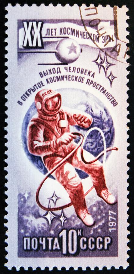 Post stamp printed in USSR show astronaut, circa 1977. MOSCOW, RUSSIA - APRIL 2, 2017: A post stamp printed in USSR shows astronaut and devoted to 20 Open Space royalty free stock photography