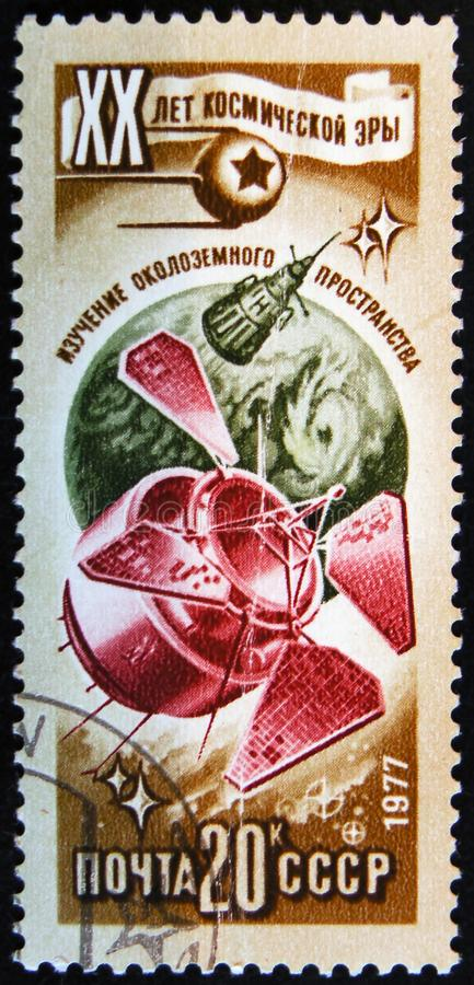 Post stamp printed in USSR shows space ship, circa 1977. MOSCOW, RUSSIA - APRIL 2, 2017: A post stamp printed in USSR shows space ship and devoted to 20 Space royalty free stock images