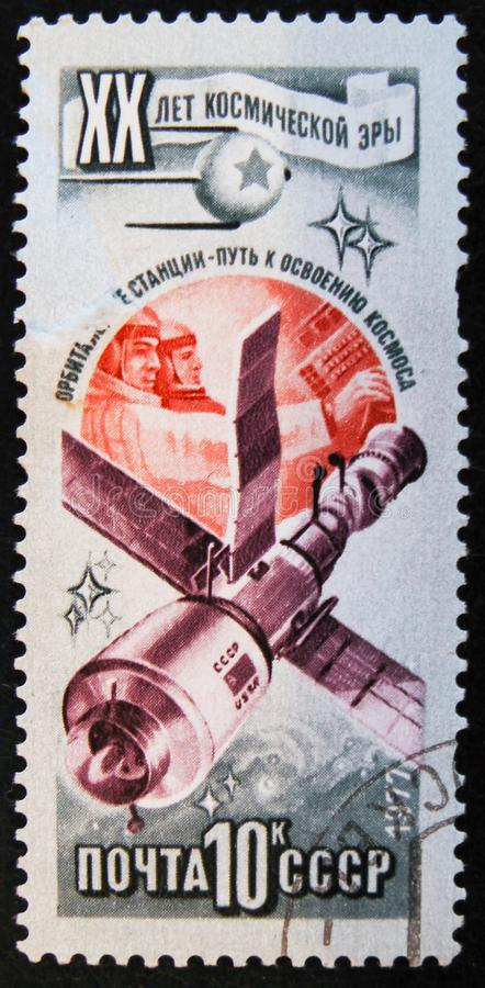 Post stamp printed in USSR shows space ship, circa 1977. MOSCOW, RUSSIA - APRIL 2, 2017: A post stamp printed in USSR shows space ship and devoted to 20 Space stock image