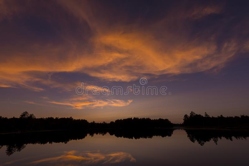 Post sunset on Spider Lake in Northern Wisconsin. Post sunset glow on Spider Lake in Northern Wisconsin, in the Chequamegon National Forest royalty free stock photo
