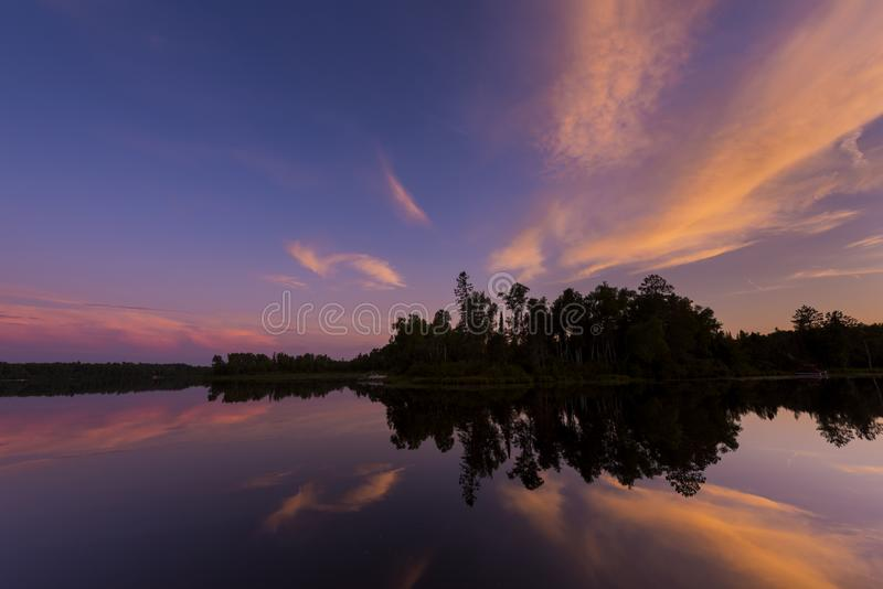 Post sunset on Spider Lake in Northern Wisconsin. Post sunset glow on Spider Lake in Northern Wisconsin, in the Chequamegon National Forest royalty free stock photos