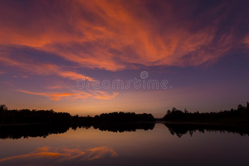 Post sunset on Spider Lake in Northern Wisconsin. Post sunset glow on Spider Lake in Northern Wisconsin, in the Chequamegon National Forest royalty free stock image