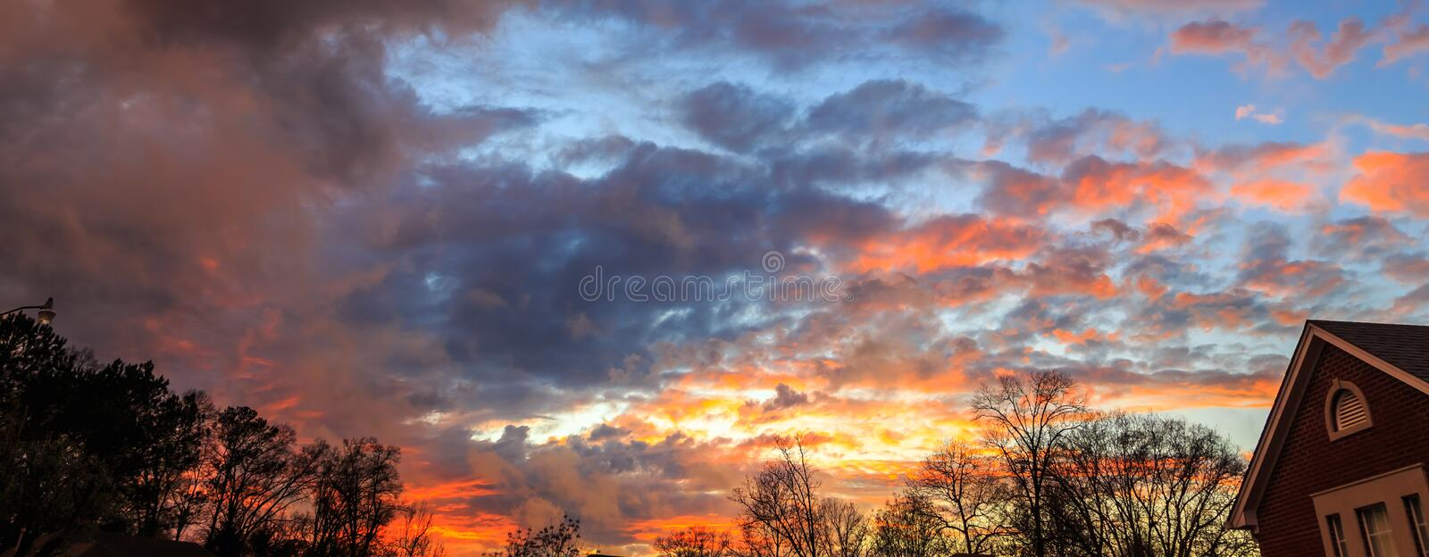 Post Tornado Watch Sunset in Montgomery, Alabama. Gorgeous orange, yellow, and blue sunset after a tornado watch in Montgomery, Alabama stock photo