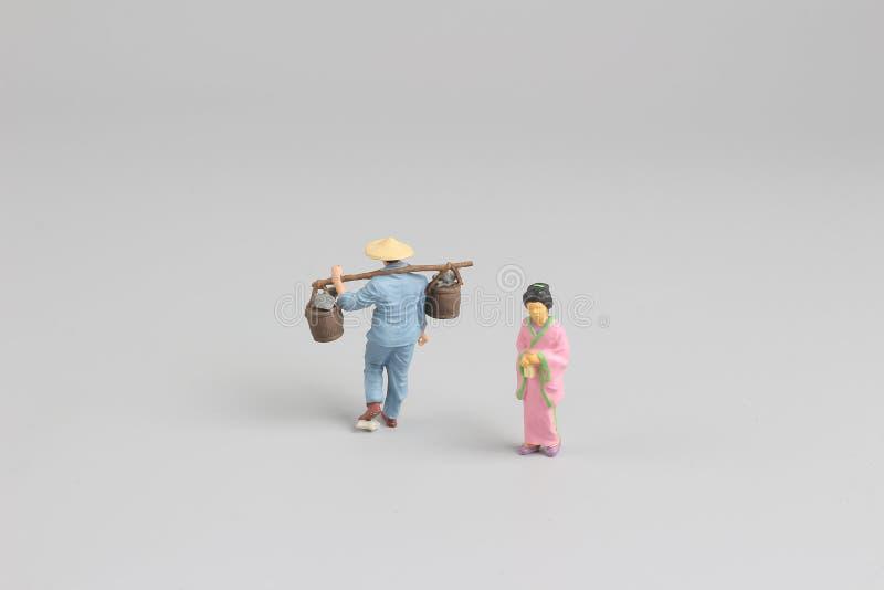 postać azjata przy odosobnionym na bielu zdjęcie stock