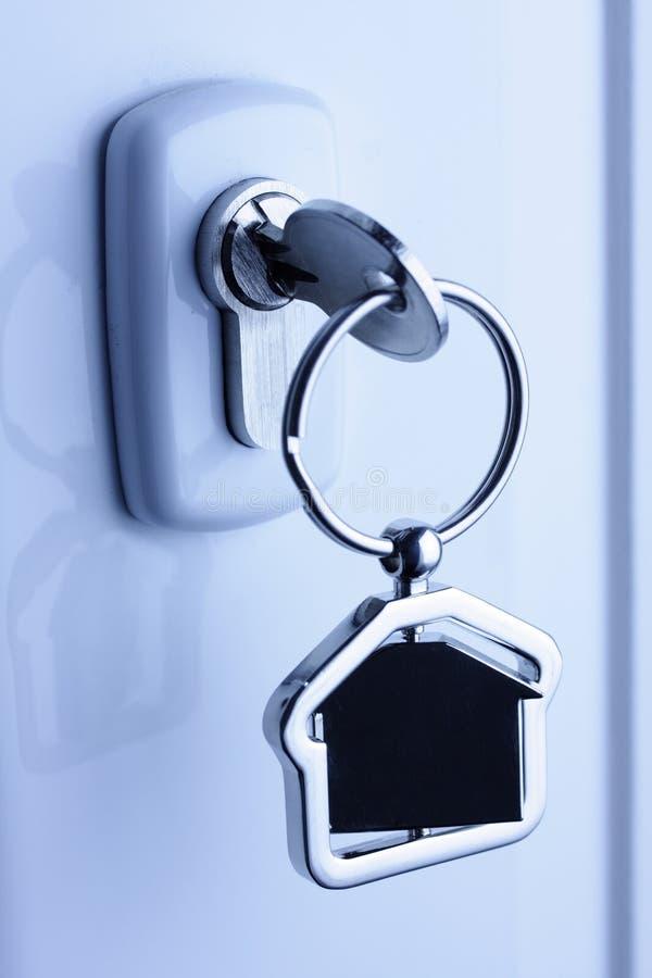 postać domu klucza kędziorka metal fotografia stock
