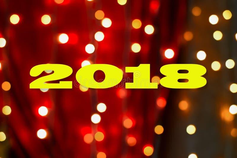 Postacie 2018 na tle świąteczny bokeh obraz stock