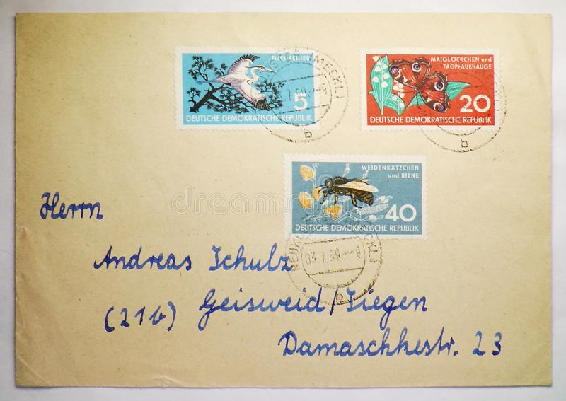Postage envelope with stamps from Germany, Federal Republic, with address written by hand. MOSCOW, RUSSIA - AUGUST 8, 2019: Postage envelope with stamps from royalty free stock photography